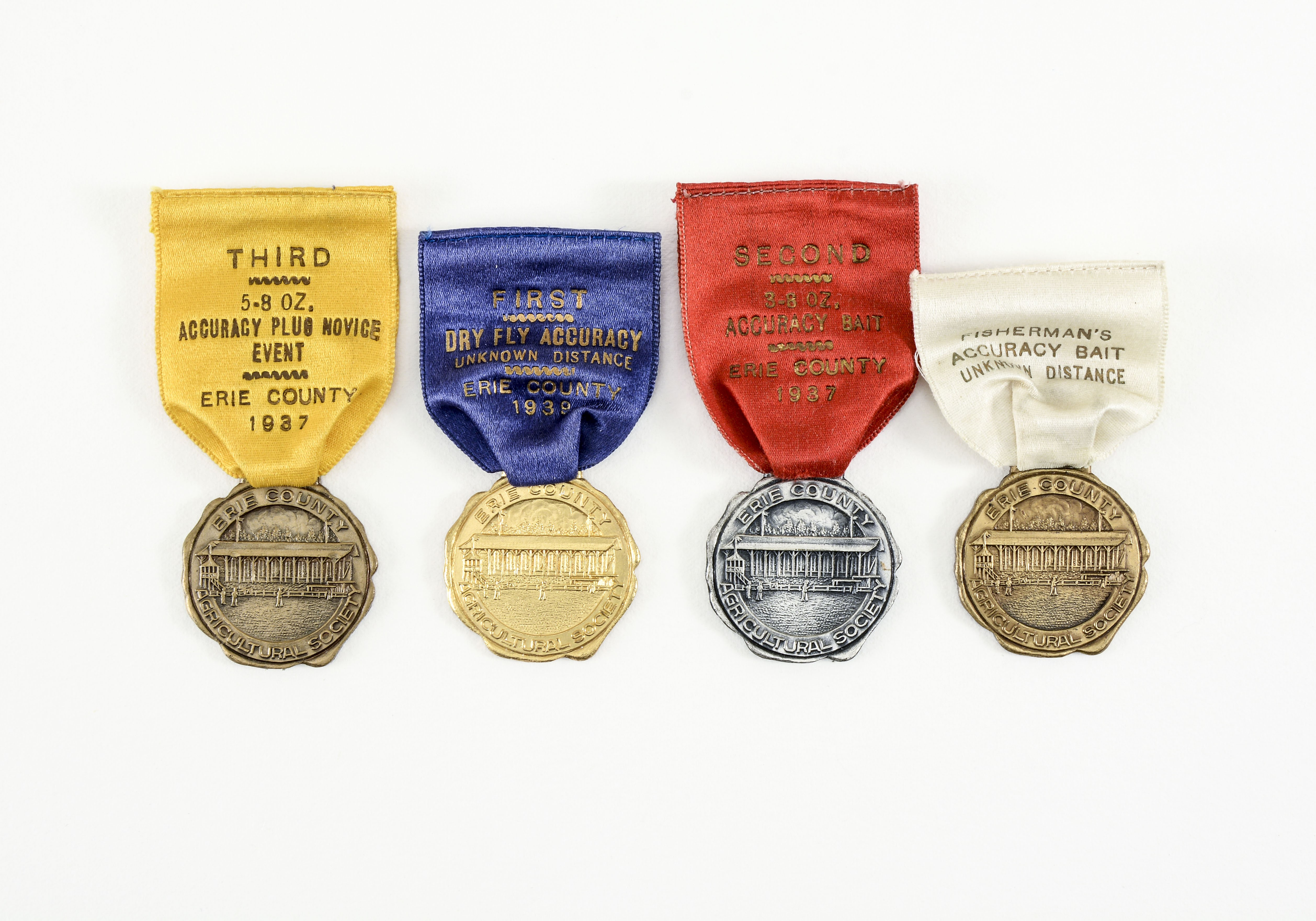 4 Erie County Tournament Casting Medals | Lang's Auction Inc
