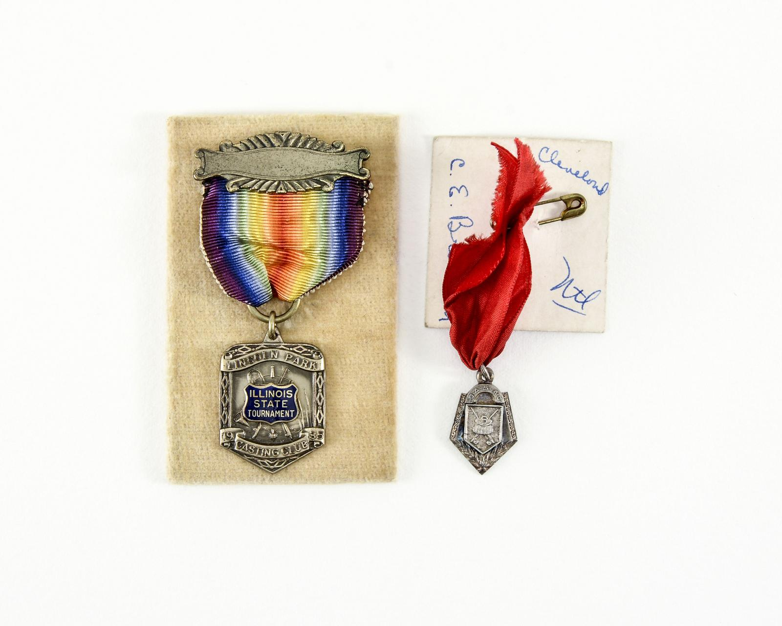 2 Eddie Braddon Casting Medals | Lang's Auction Inc