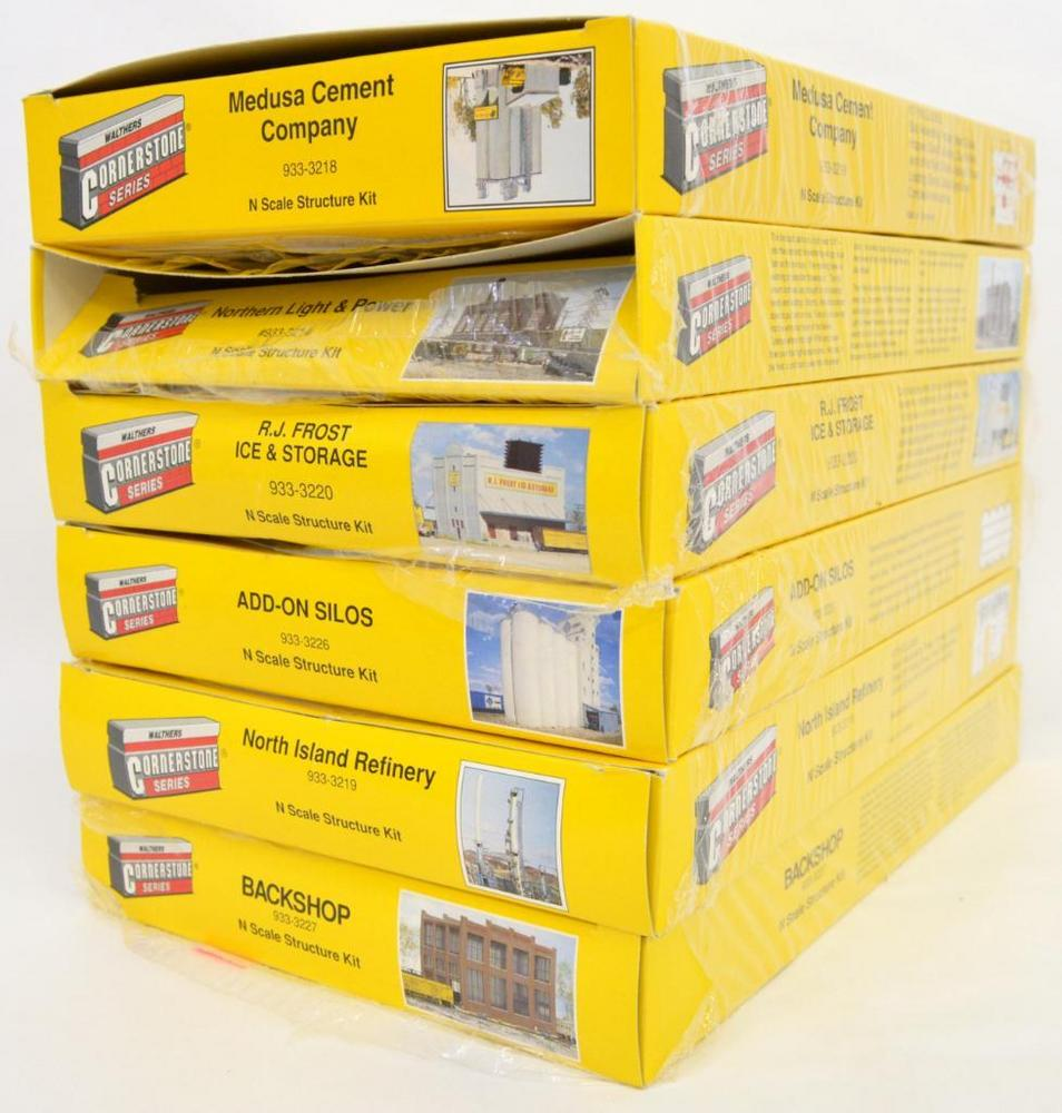 Six Walthers Cornerstone Series N Scale Building kits In open boxes